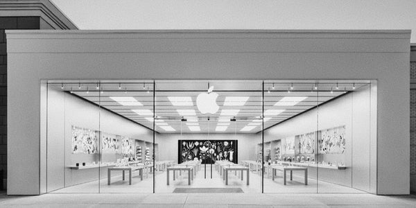 Photograph of the Apple Store at dusk which is probably the best Apple ad ever