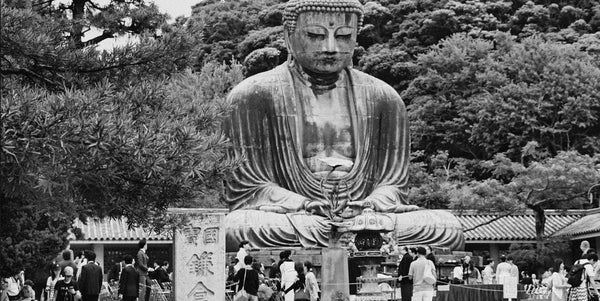 Photograph of statue of Buddha who says to be careful of the words we chose because people can be influenced for good or ill