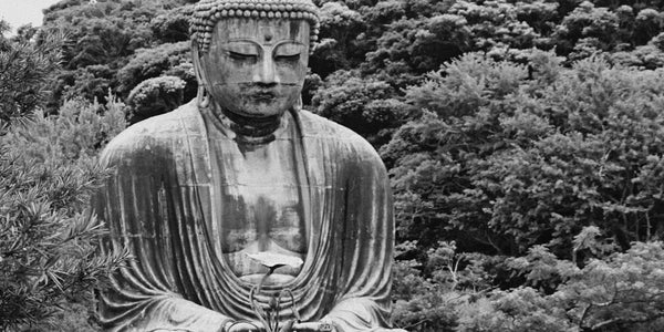 Photograph of a statue of Buddha reminding us to chose our words carefully as they can influence for good or ill