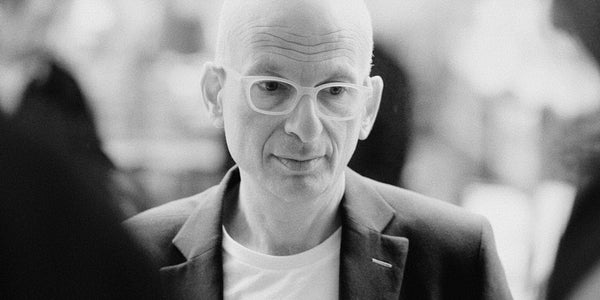 Photograph of Seth Godin proclaiming that conventional websites can only produce conventional results