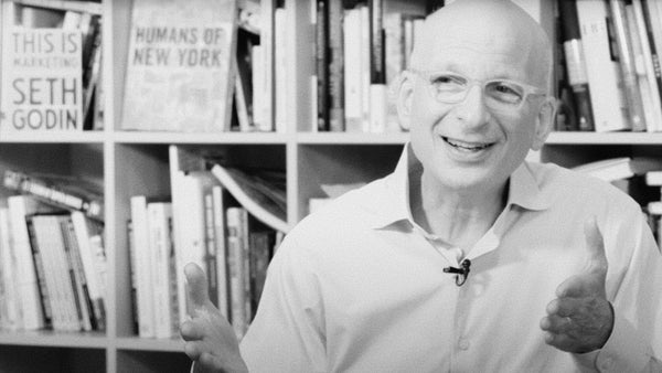 Photograph of Seth Godin from an interview where he explains that if you want to build an important new brand, if you want to grow the brand, you cannot use old technique because we know they do not work anymore