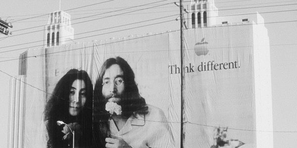 "Large billboard of John and Yoko Lennon as part of Apple's groundbreaking ""Think Different"" campaign"