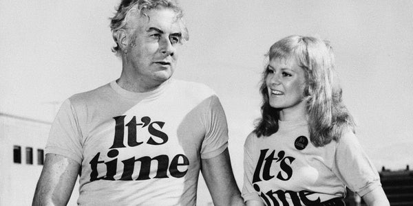 Photograph of Gough Whitlam and Little Pattie in t-shirts showing the power and memorability of a simple slogan