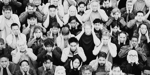 Photograph of a crowd of people blocking their ears to show the biggest illusion of communications