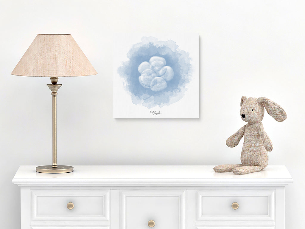 Watercolor embryo art on canvas wood wrap hanging in baby's nursery.