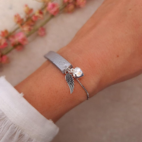 Silver leather and charm bracelet