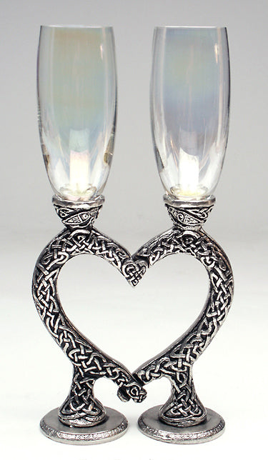 clear wedding heart wine glasses positioned in the shape of a heart