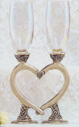 clear wedding Celtic flutes positioned in the shape of a heart