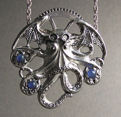 pewter necklace of a Cthulhu holding gems in it's tentacles.