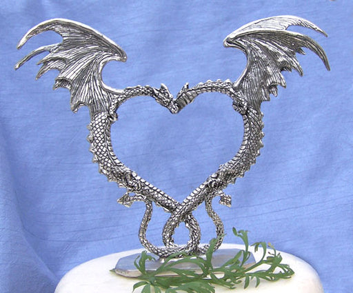 Nuzzling dragons with wings in the shape of a heart wedding cake topper