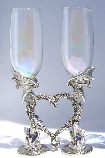 set of nuzzling dragons in the shape of a heart on top of gems