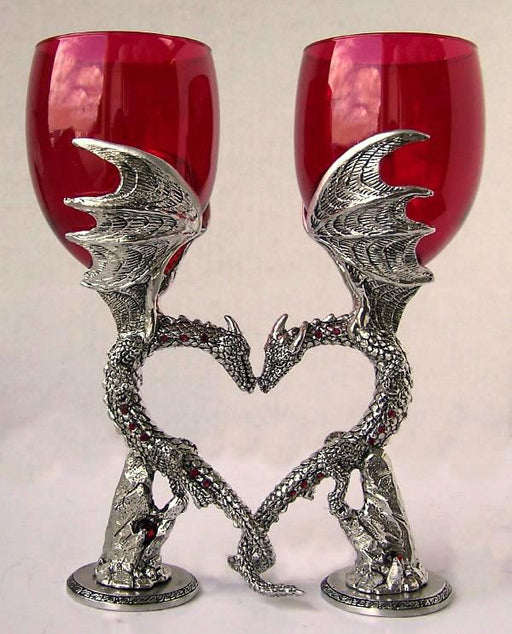 set of dragon wedding wine glass positioned to form a heart with dragons nuzzling and inlayed with gems