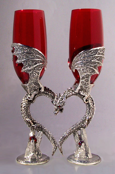 two dragon wedding wine flutes that are nuzzling and positioned to form a heart inlayed with gems.
