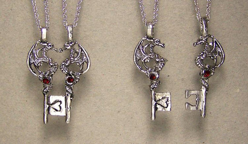 dragon pair neckalces inlayed with gems on a key that fits together
