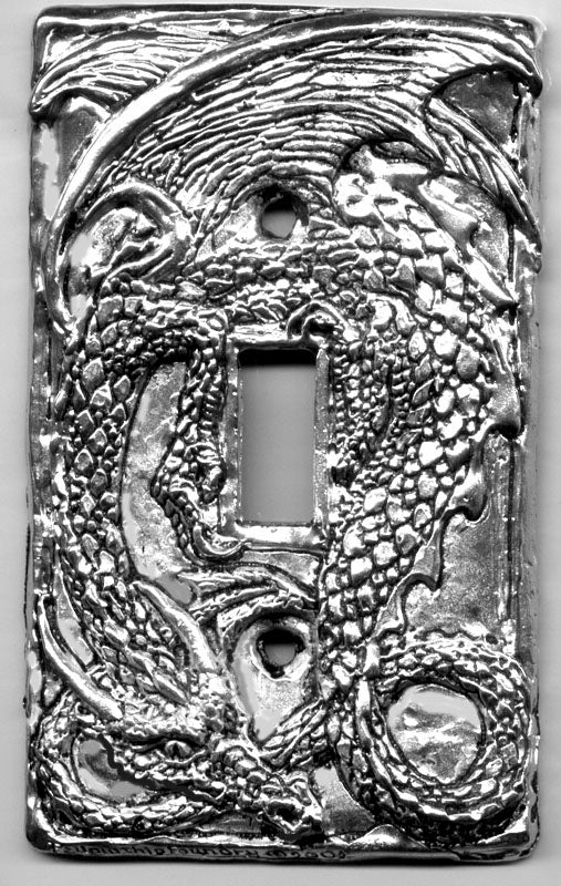 single tailed dragon switch plate made from metal