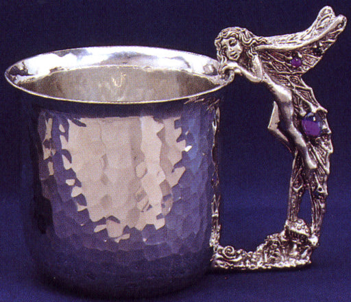 hammered pewter cup with fairy looking in and same fairy as the handle inlayed with gems.