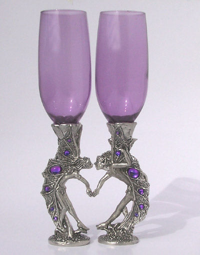 purple glass colored wine flutes with male and female fairies for base inlayed with gems and positioned holding hands and ready for a kiss