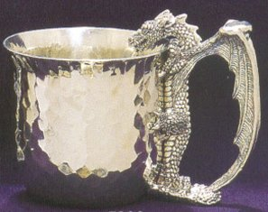 hammered pewter cup with dragon as handle looking into cup