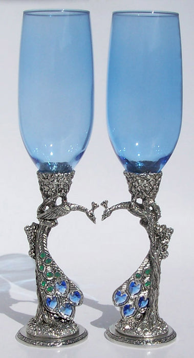 two royal blue wedding peacock heart flutes nestling each other