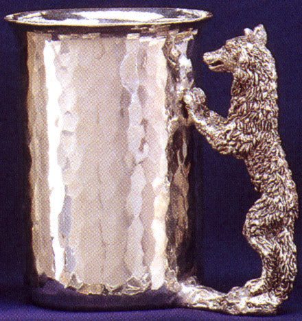pewter cup with wolf standing with limbs attached to cup for handle