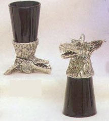 shot glass with a growling wolf made of pewter