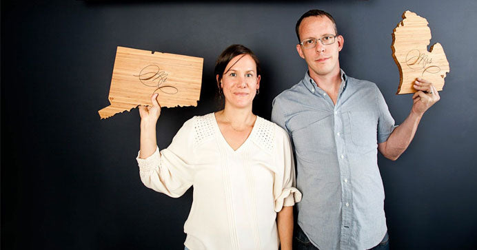 Amy and Bill display their custom-made state shaped cutting boards