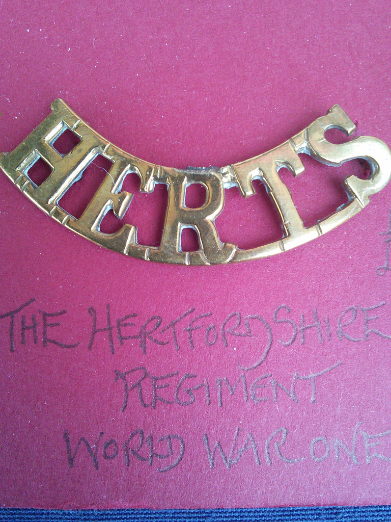 Original WWI brass shoulder title The Hertfordshire Regiment