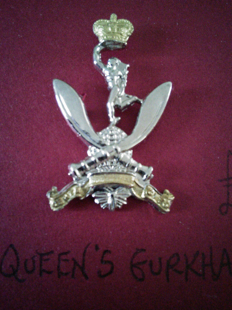 Original cap and beret badge The Queen's Gurkha Signals