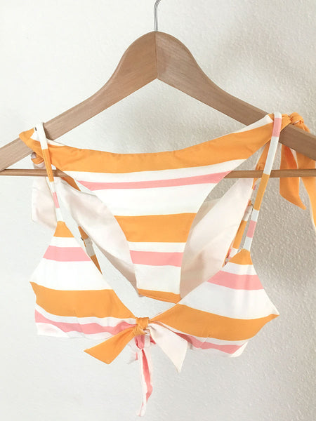 Centre tie bikini top in Sunset stripe (yellow & pink) on hanger