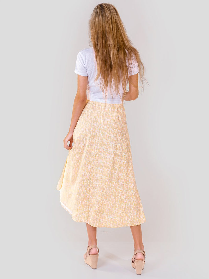 Midi skirt in Yellow floral with long centre leg split - back