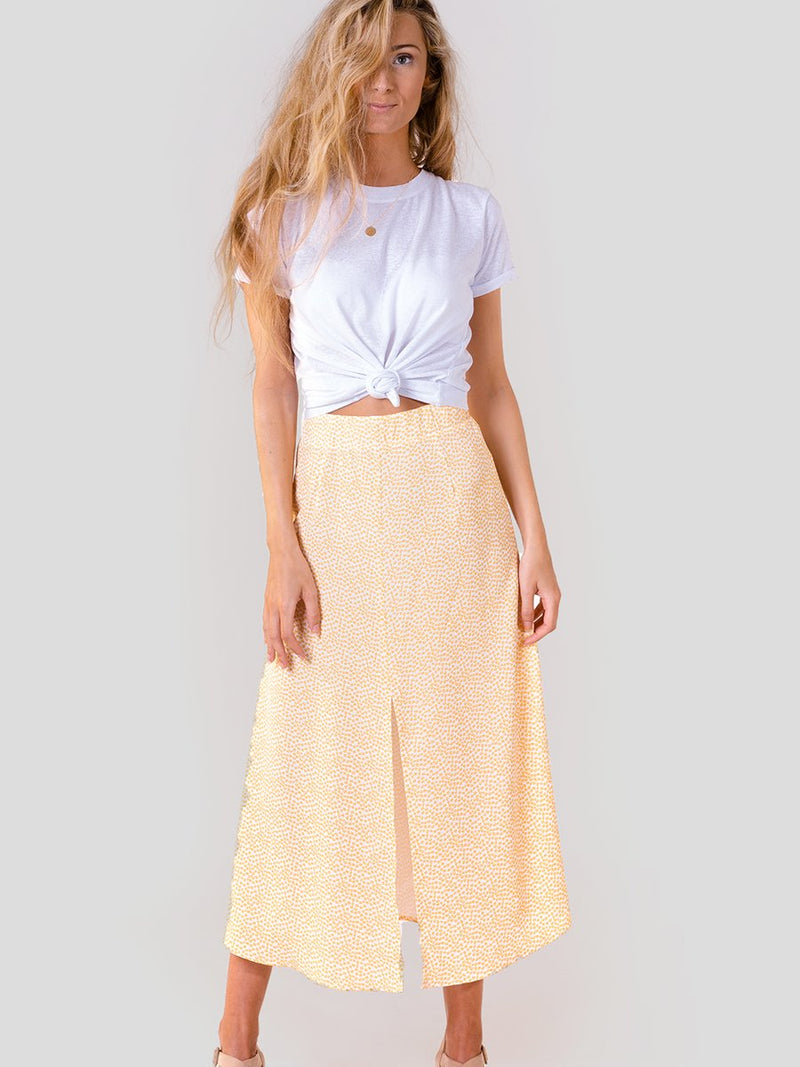 Midi skirt in Yellow floral with long centre leg split