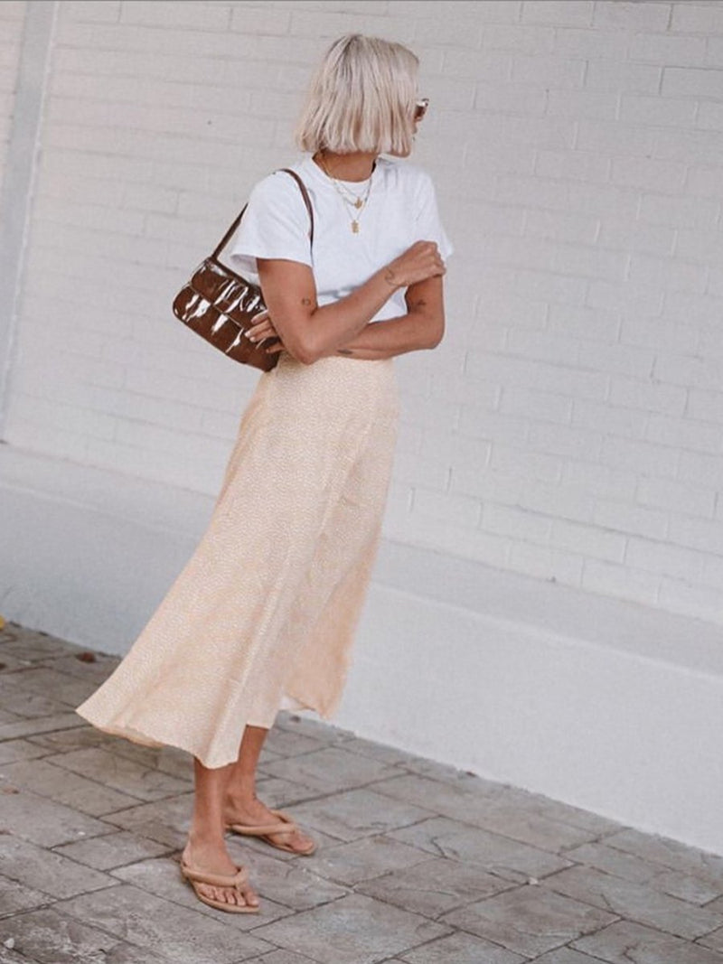 Karissa Sparke wears our Split midi skirt in yellow floral