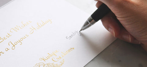 Hand-written message in company greeting card