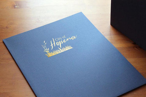 Low minimum pocket folders with company logo on front cover