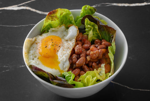 Salad with sofrito beans and fried egg