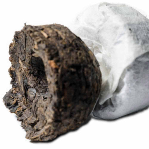 Puerh - black tea compressed into a mini cake and individualy wrapped, a famous chinese black tea
