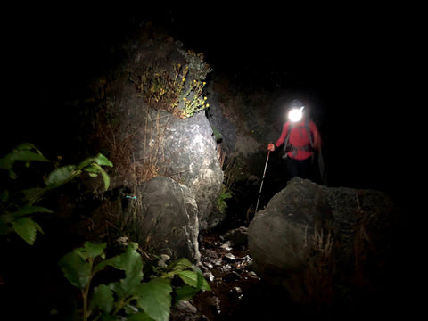 Hiking in the dark with a headlamp.