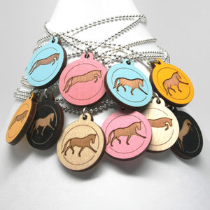 Pendants with a purpose, jumping horse necklace and trotting horse necklace
