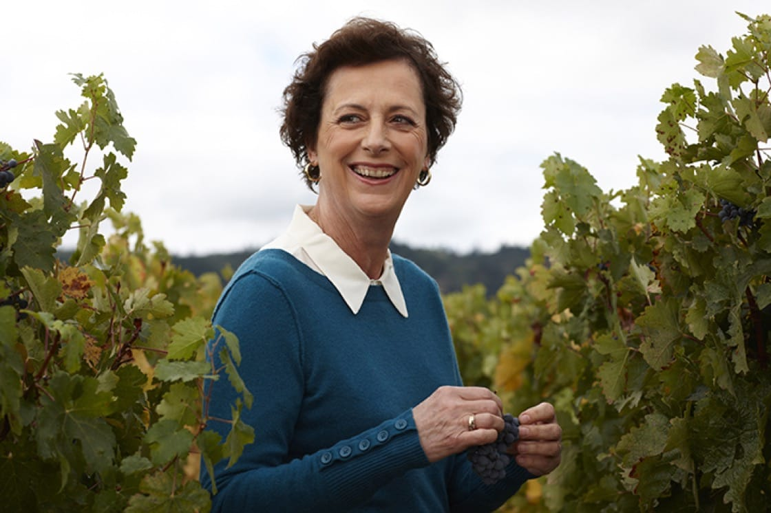 Geneviève Janssens, Chief Winemaker for Robert Mondavi smiling amidst the grapevines.