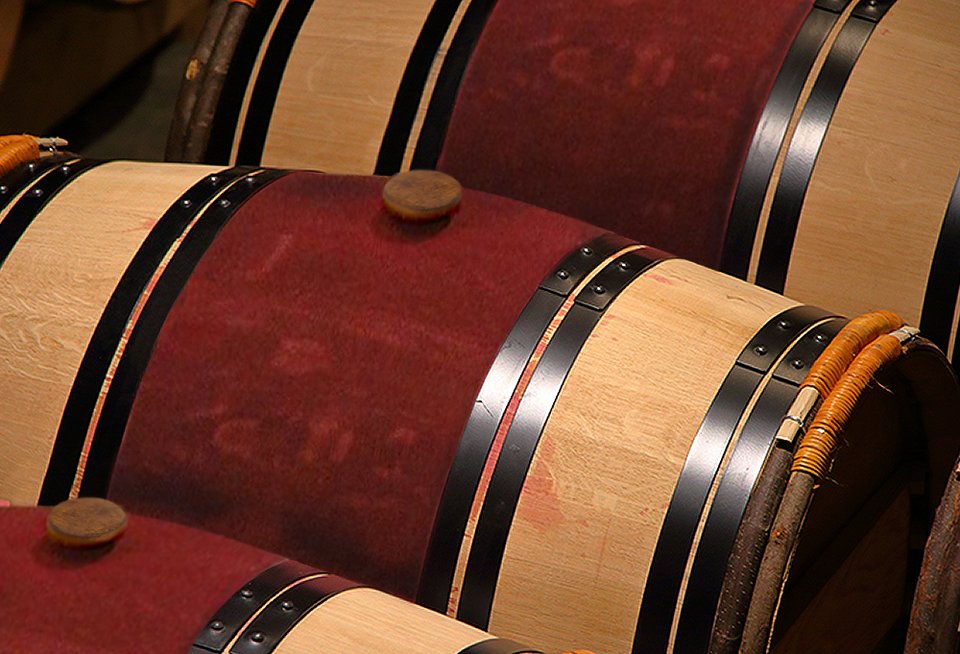 Wine barrels painted with red wine in the wine cellar of Robert Mondavi Winery.