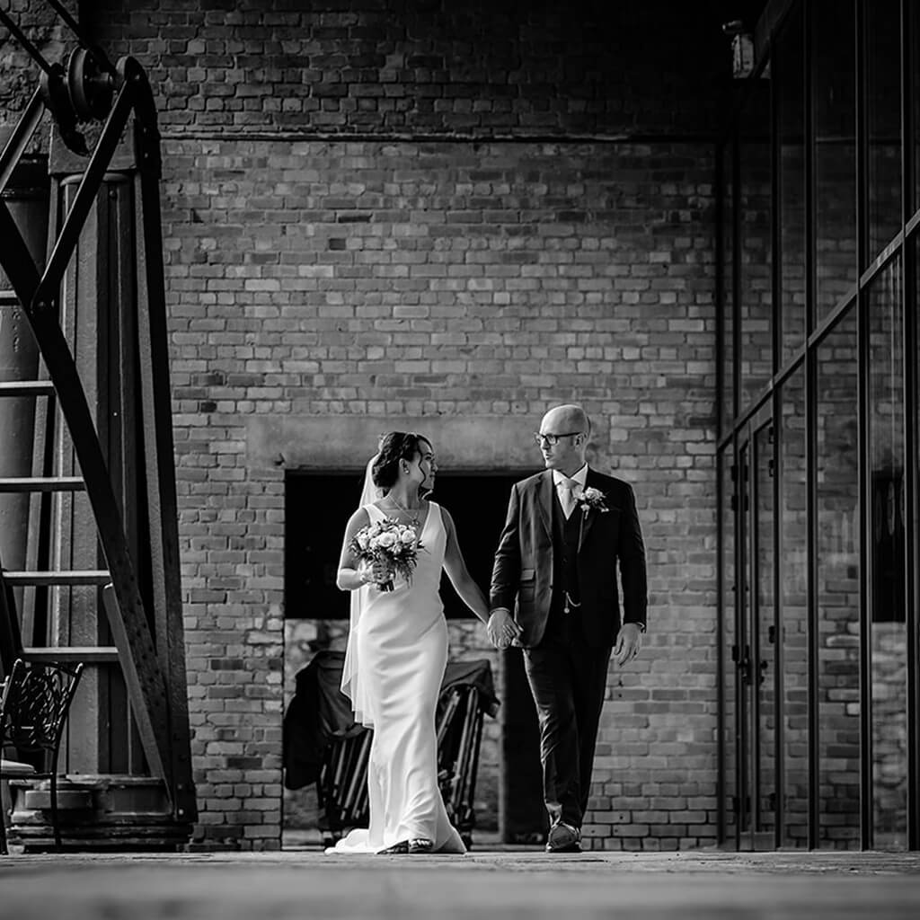 Christina Devine bride and groom walking hand in hand