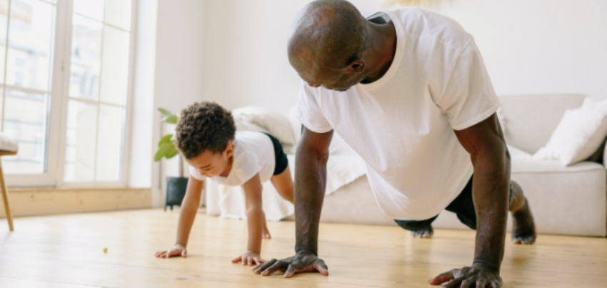 dad and son doing a push-up