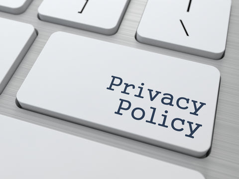"""Shown here is a photo of a computer keyboard with the words """"Privacy Policy"""" on what is typically the """"Enter"""" or """"Return"""" key."""