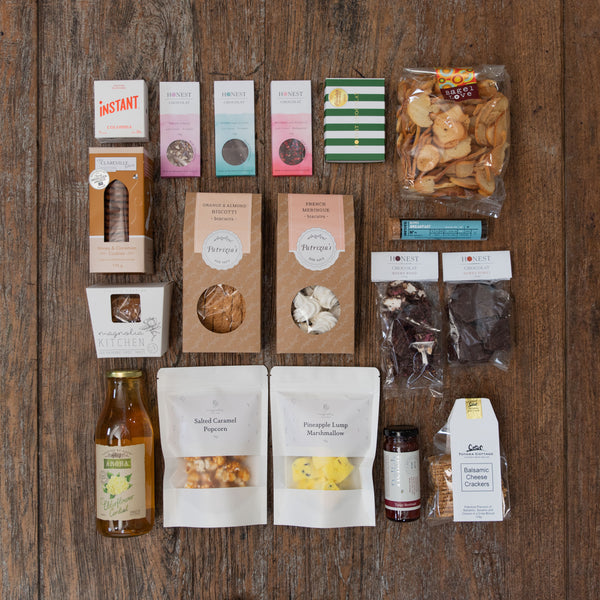 A huge selection of both delicious sweet and savoury treats that includes fudge, caramel popcorn, marshmallow, biscuits, hokey pokey, rocky road, meringues, biscotti, bonbons, chocolate, tea, coffee, cordial, bagel crisps, relish and crackers.