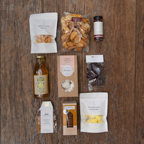 A yummy assortment of both sweet and savoury products caramel popcorn, marshmallow, biscuits, hokey pokey, meringues, bagel crisps, cordial, crackers and relish.