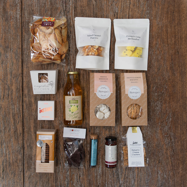 The perfect mix of sweet and savoury sure to delight that includes fudge, caramel popcorn, marshmallow, biscuits, hokey pokey, meringues, biscotti, tea, coffee, cordial, bagel crisps, relish and crackers.