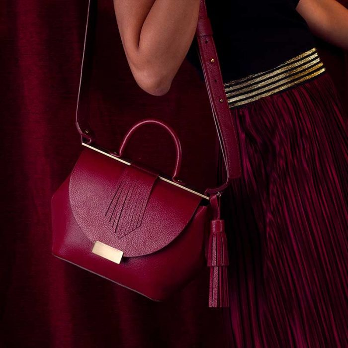 Handbag by Marco Trevisan: small handbag in burgundy leather with handle, shoulder strap and golden details