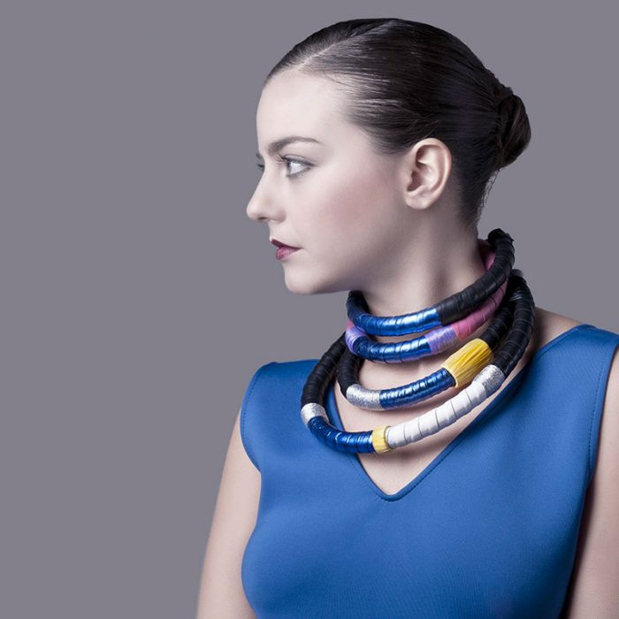 Model wears semi-rigid leather necklaces from the Masai collection by Anna Maria Cardillo