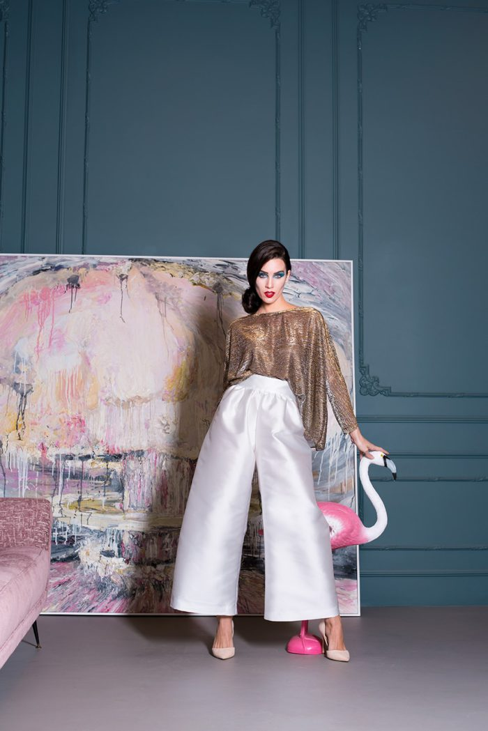 total look chiara perrot with gold blouse and white palazzo pants