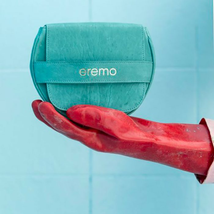 Handbag by Eremo Bag: teal vegetable tanned leather, round shape, horizontal band with logo detail